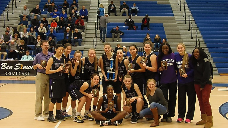 The Champions of Rebel Round Ball pose with their trophies.