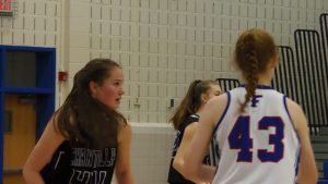 The Chargers' Mary Clougherty patrols the lane on defense.