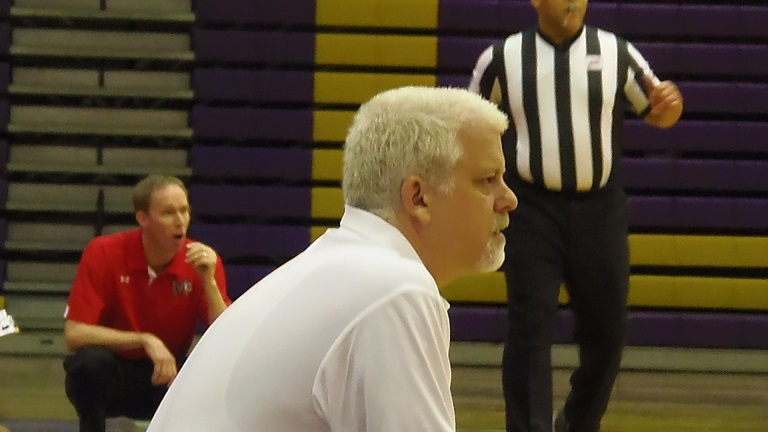 Lake Braddock coach Brian Metress (front) and McLean coach Mike O' Brien watch the action intently.
