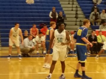 Robinson's Anthony Douglas fronts South Lakes' Emmanuel Aghayere.