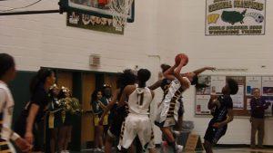 Woodbridge junior guard Paris McBride attacks the rim.