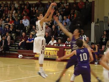 Oakton's Braeden Johnson drains two of his game-high 23 points.