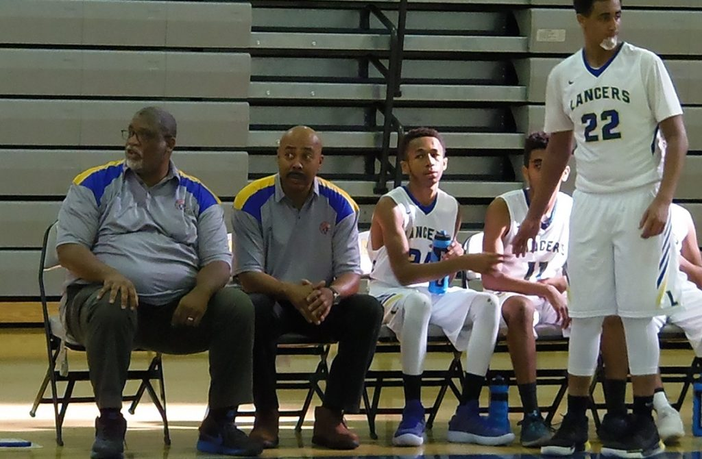 Veteran coach Robert Barnes (left) looks to bring a winning tradition back to Lee.