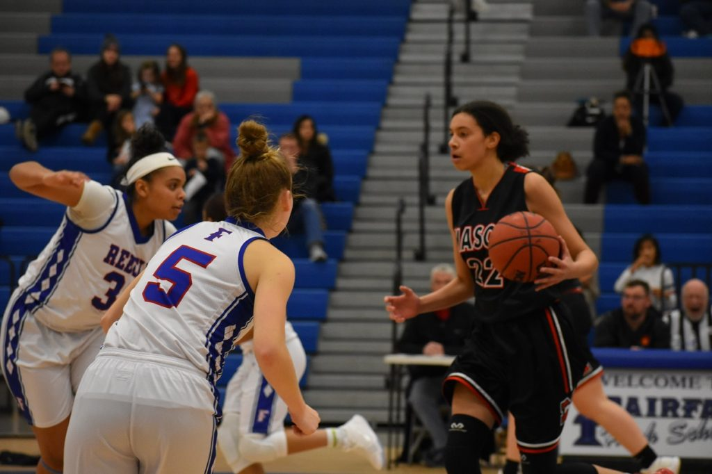 Mason sophomore Daria Douglas (12 points) tries to get by Fairfax's Emma Heslep and