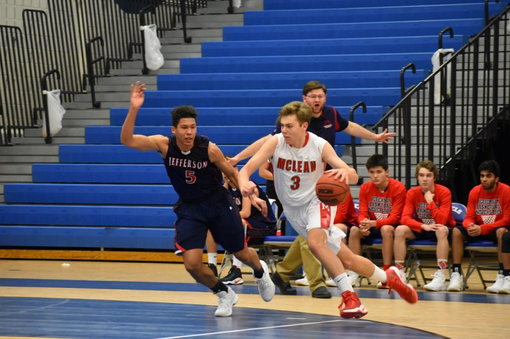 McLean's Sean Senft (11 points) tries to get past TJ star guard Noah Barnes.