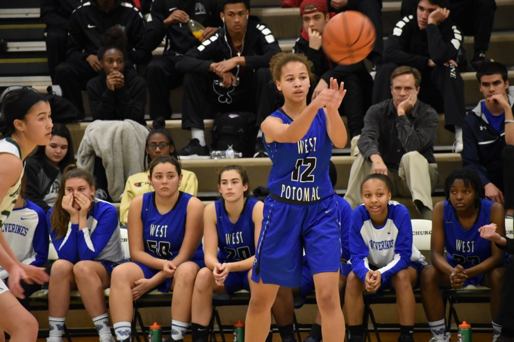 West Potomac's Tyler Mackie moves the ball around the perimeter.