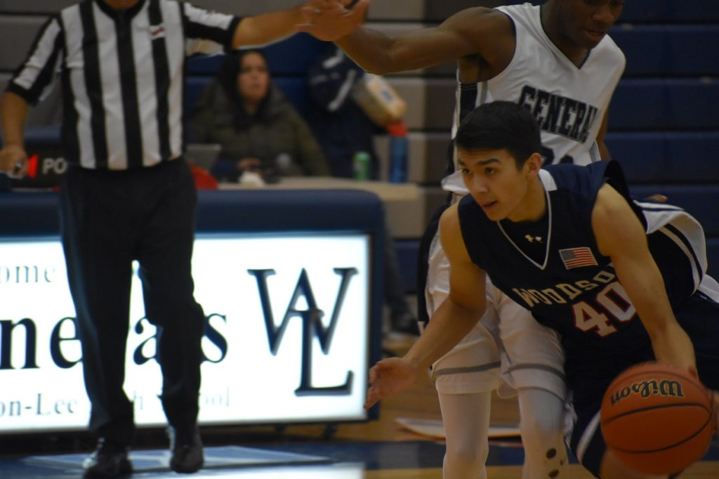 Woodson's Joey Lee navigates around W-L pressure. When the Cavs beat the Generals' press, they got easy looks.