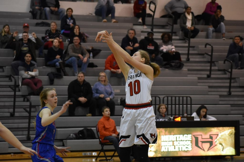 Heritage sophomore Lauren Phelps drills a jumper. Phelps led the Pride with 14 points.