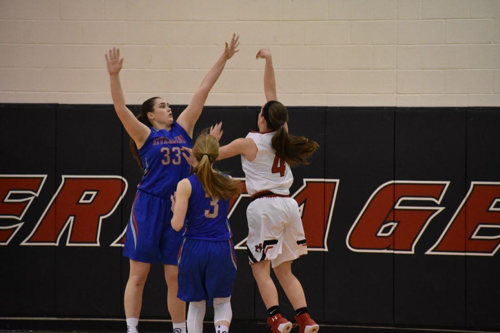 Heritage's Grace Sibley attacks the rim over Riverside's Lauren Eichenlaub.
