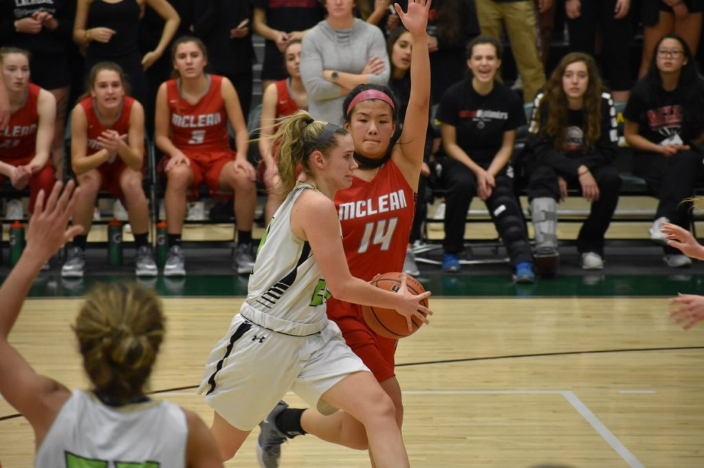 Langley's Emily Shively drives as McLean's Kaela Moskowitz closes in.