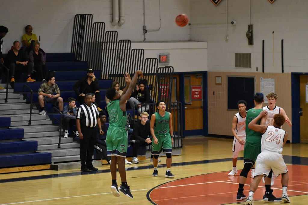 The Stallions' William Wilson takes the three  after getting the pass from Noah Bullock in teh corner.