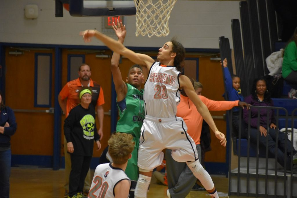 West Springfield's Malachi Hester gets the block.