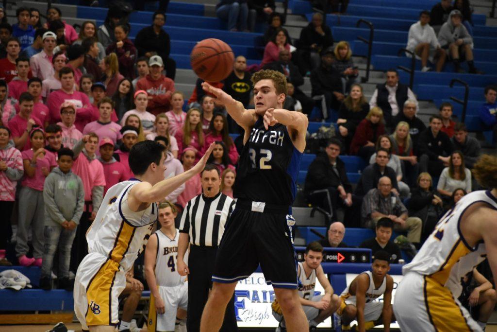 Fairfax Sophomore Chase Ackerman threads a pass through the Braddock defense.