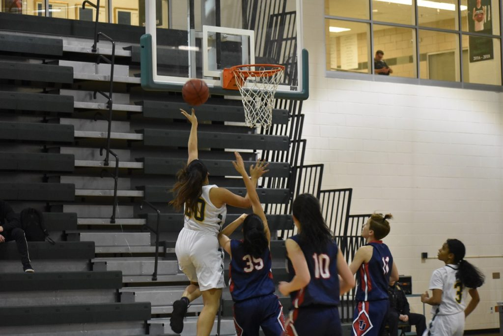 Wakefield's lone senior, Jami Tham, explodes to the rim for two of her nine points.