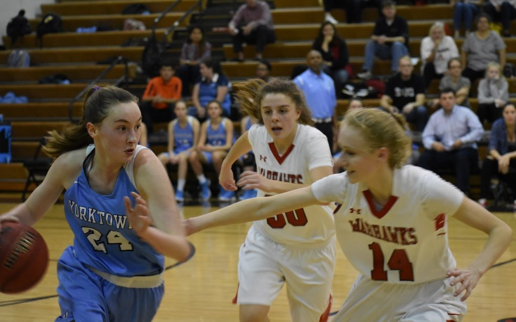 Yorktown's Liz Shean (left) drives against Madison in the regional playoffs.