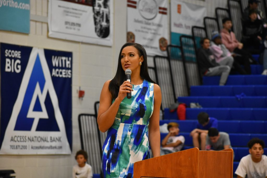 Christy Winters-Scott speaks to the crowd during her jersey retirement ceremony.