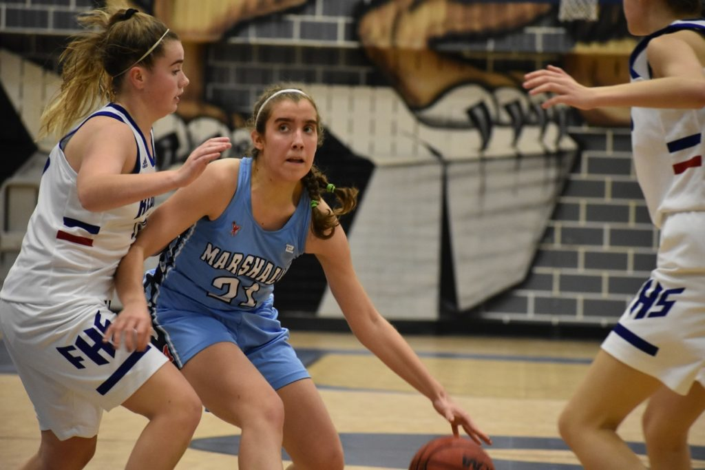 Marshall sophomore Christina Trivisonno (21 points) attacks the lane against Fairfax.