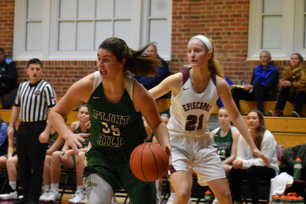 Versatile senior forward Claire Miller drives to the hoop for the Huskies.