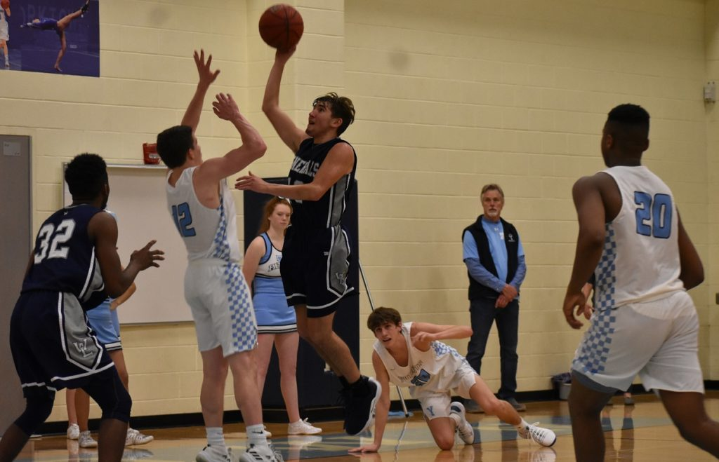 Mariano Dias gets to the rack for Washington-Lee.