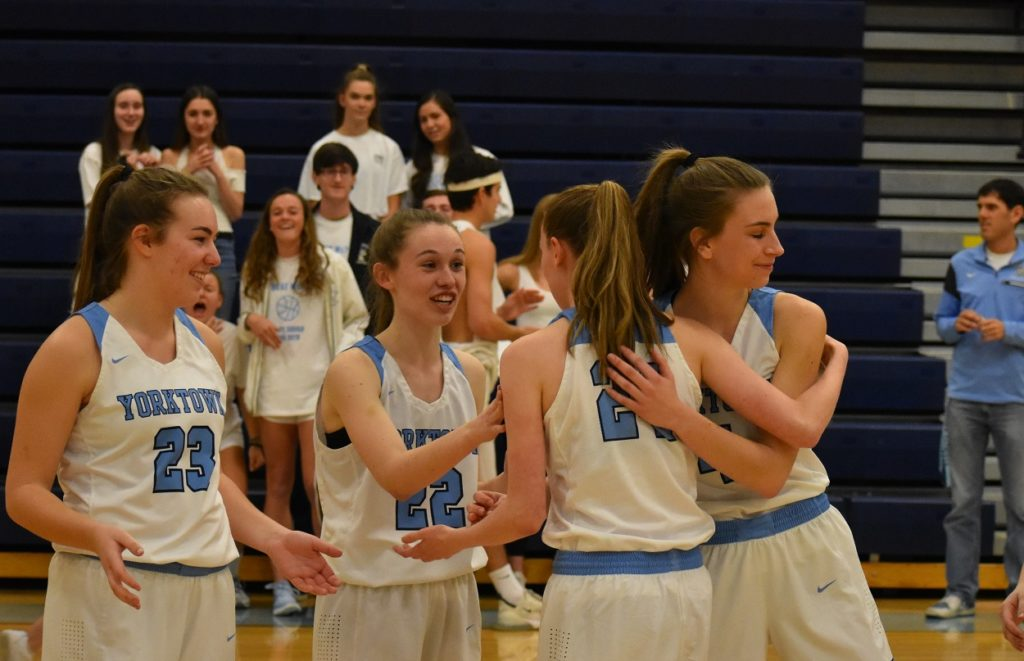 Maggie Shipley and the Patriots embrace Liz Shean, announced as a starter despite her torn ACL.