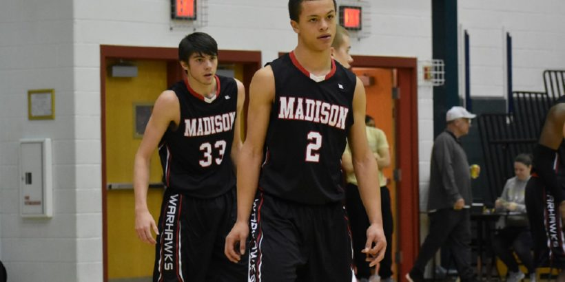 AJ Arnolie (front) did it all for the Warhawks Saturday night. He is a big key to Madison's postseason chances.