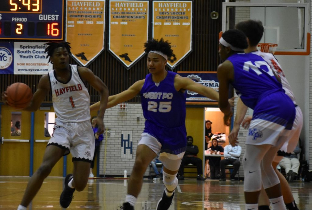 Hayfield's Mike Joiner (13 points) drives the lane.