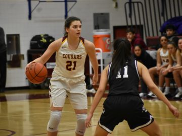 Oakton junior Grace Meshanko handles the ball on the perimeter. She also did damage inside (10 points, eight rebounds)