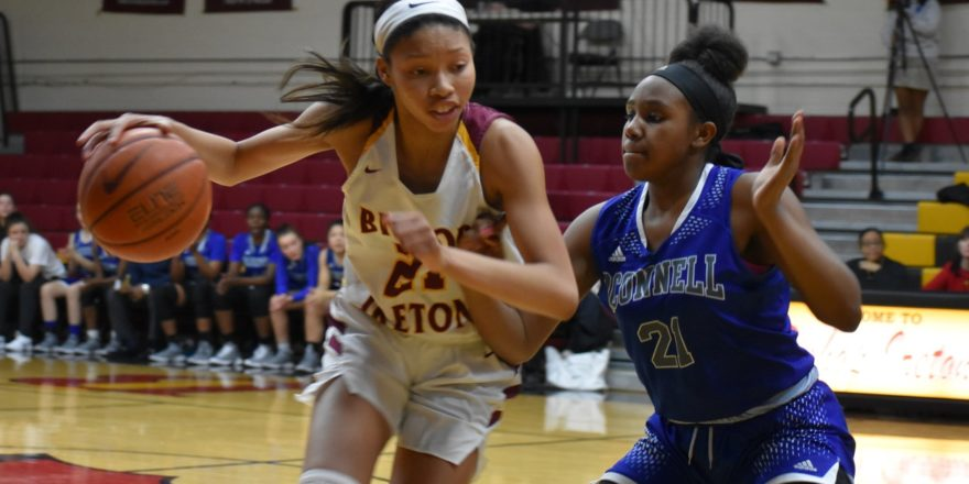 Bishop Ireton's Kennedy Clifton goes to the hoop versus O'Connell.