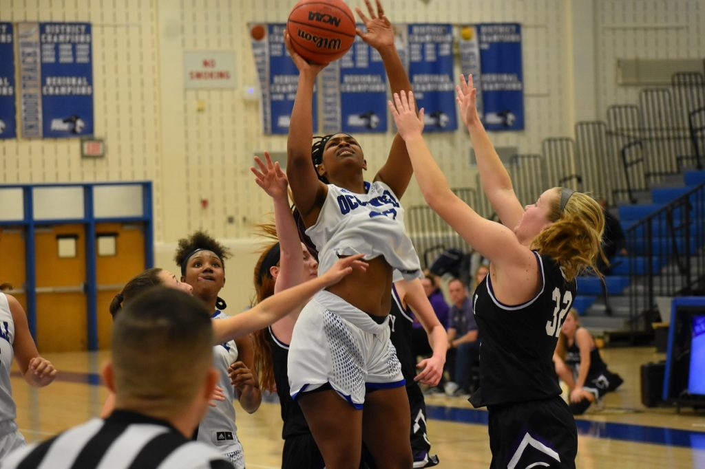 Ajia James (14 points) powers through the Chantilly defense for a bucket.
