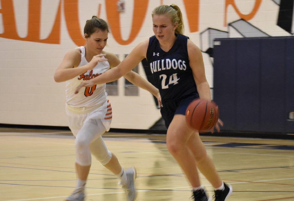 Briar Woods' Drew Hoehner (four bench points) makes life hard for Taylor Hafer (nine points) and she advances upcourt.
