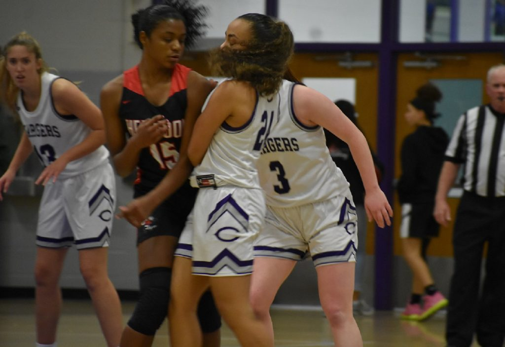 Gritty Chantilly freshman Sara Huffman (nine points) sets the screen on Herndon's Jailyn Alston.