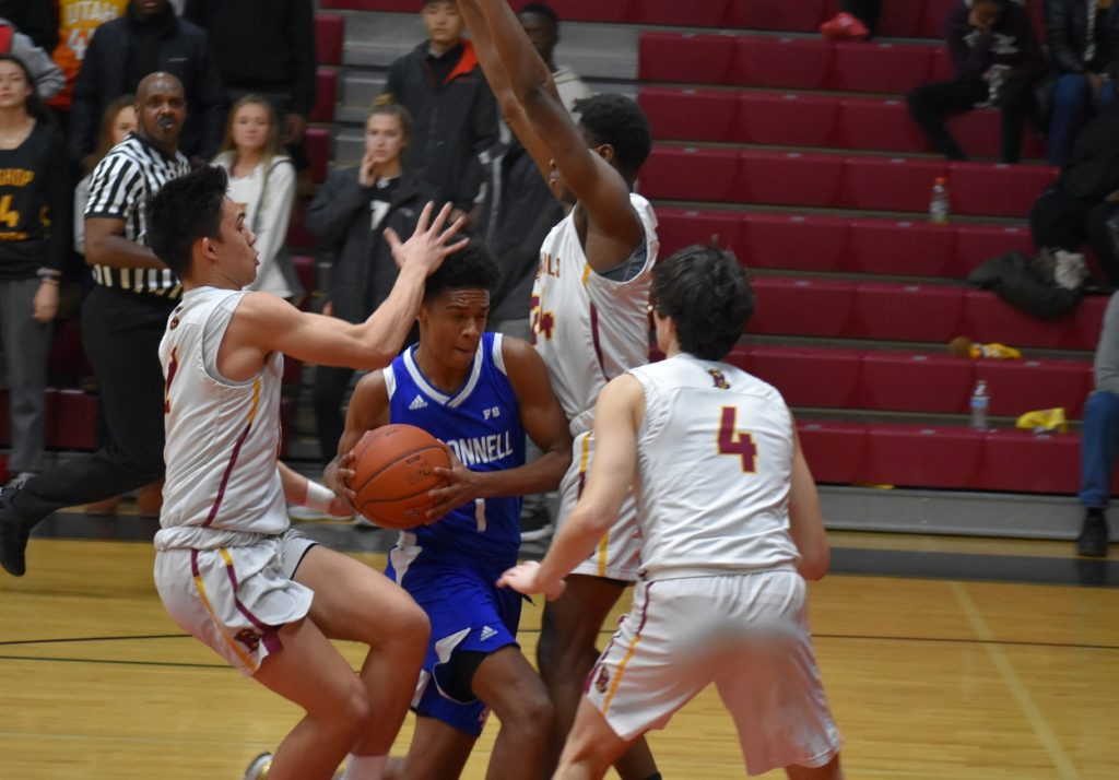 O'Connell sophomore guard Paul Lewis gets triple-teamed by the aggressive Cardinal defense.