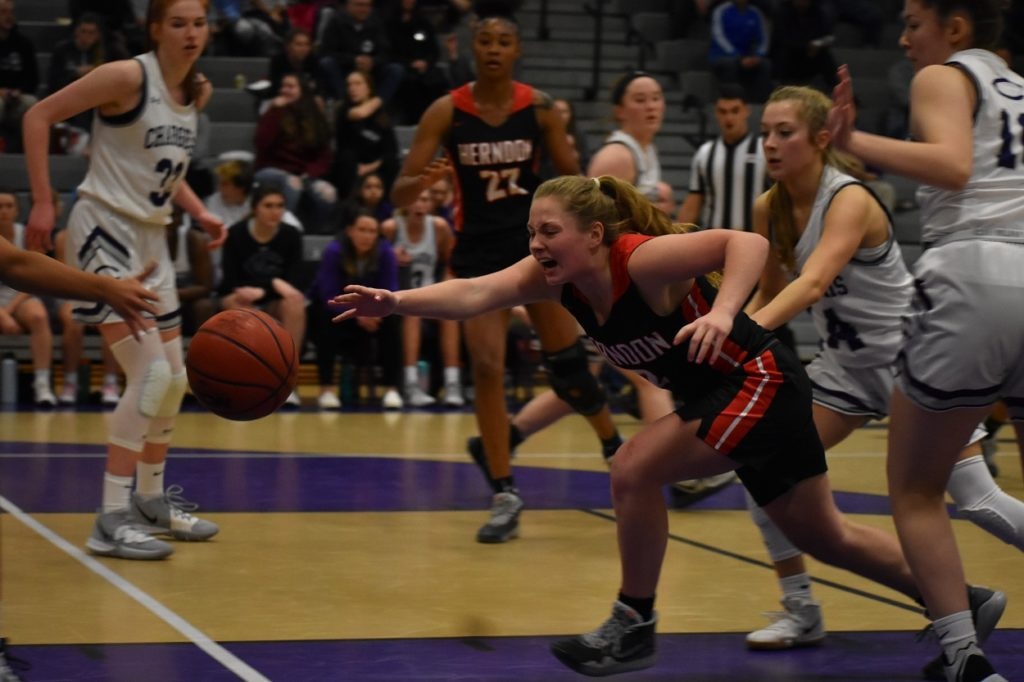 Herndon's Maddie Kimble (26 points) dives for a loose ball amongst the swarming Charger defense.