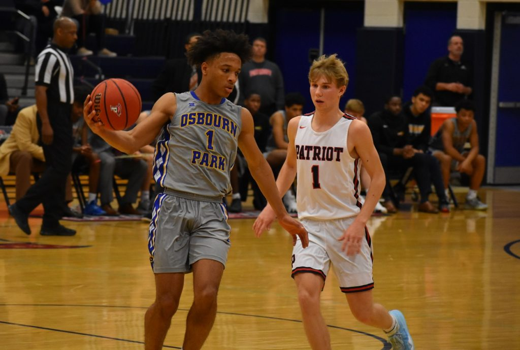 Ethan Wilson, shown here guarded by Blue, registered his 1,000th career point.