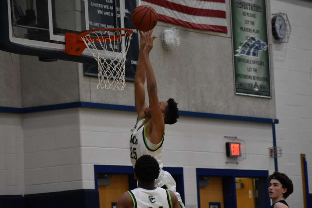 South County's Trenton Picott finishes at the rim