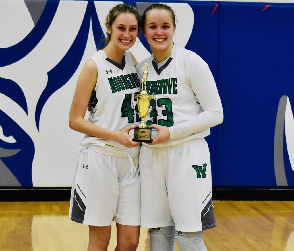 Woodgrove's seniors, Cameron Depee and Sophia Coates, pose with the hardware after the win.