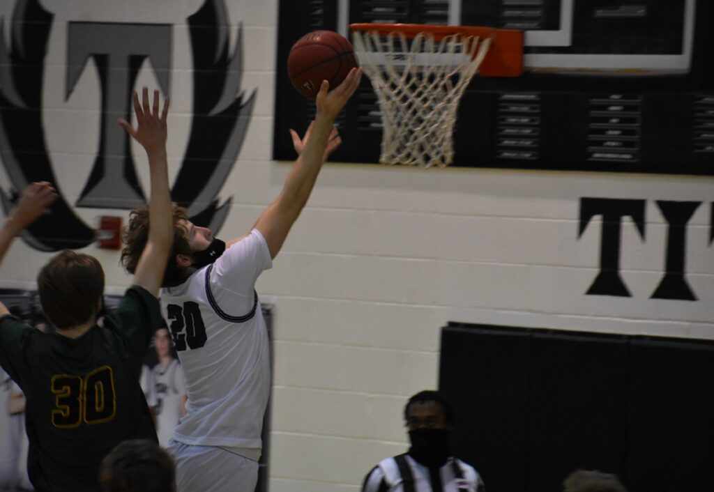 Dominion's Justin Mann finishes at the rim. Mann led the Titans' typically balanced scoring with 11 points.