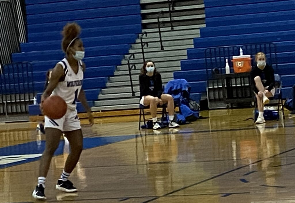 Danea Mackey brings the ball up the court